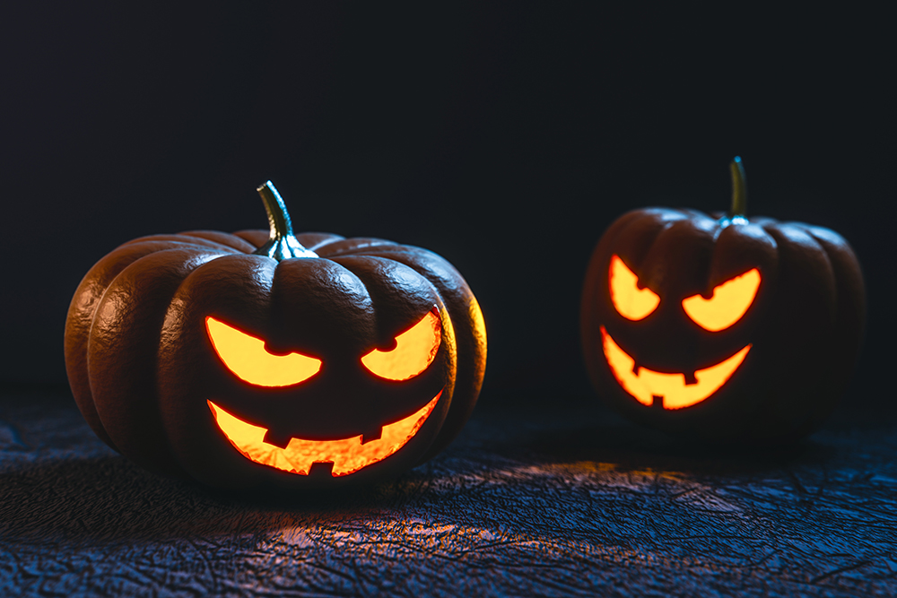 photo of faces carved into halloween pumpkins