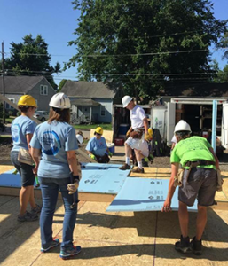 photo of habitat for humanity crew building home