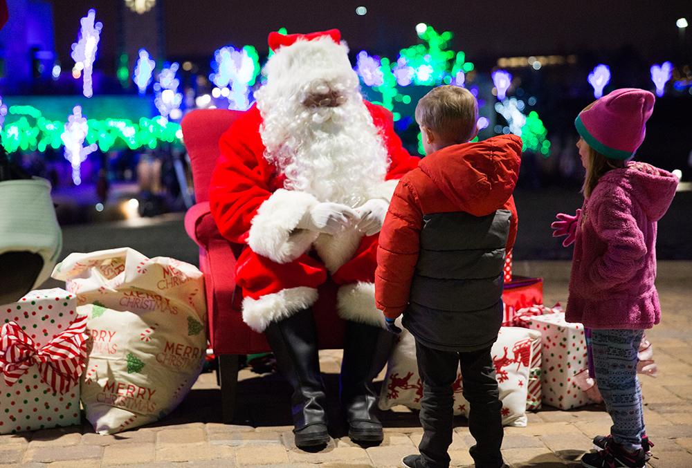 Photo of little boy meeting Santa at the Point of Lights event