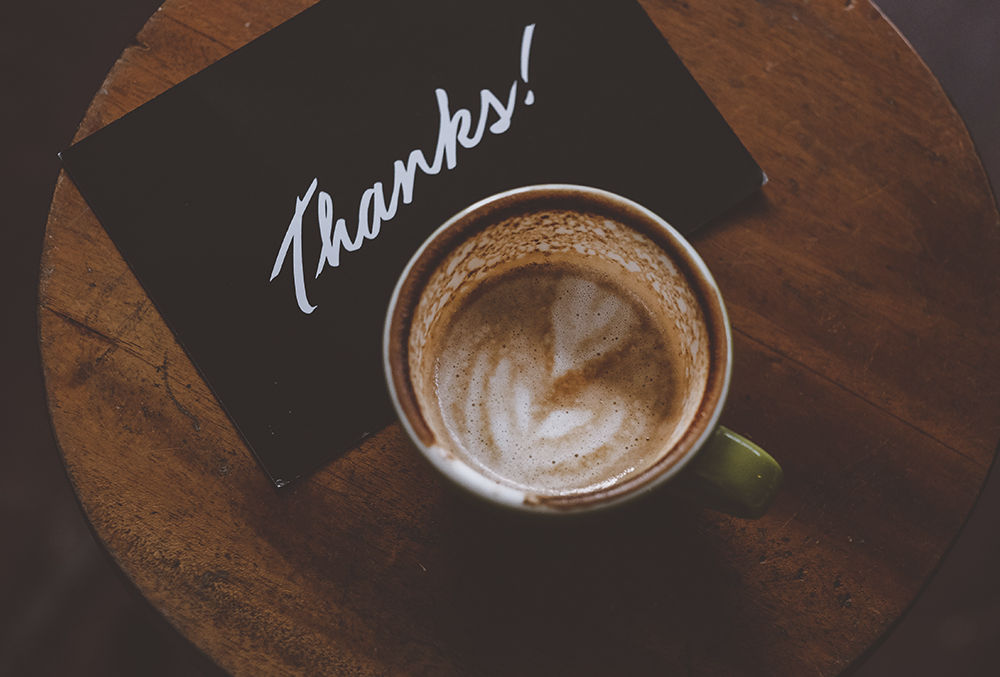 Thank you note next to coffee cup