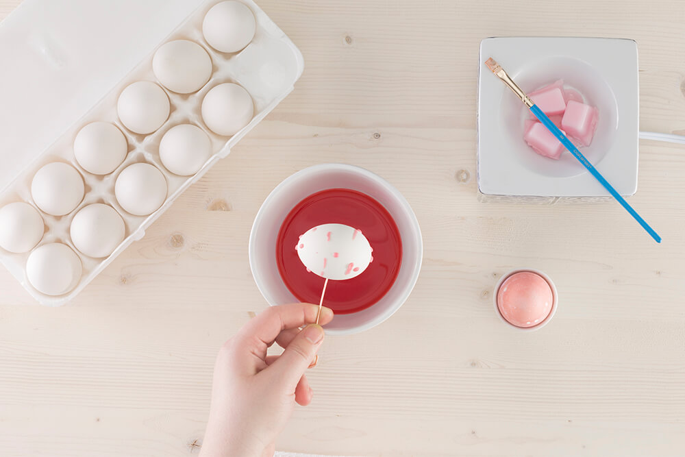 Photo of person dying eggs aside Scentsy Warmer