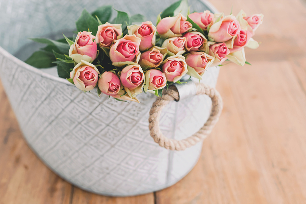 Photo of a basket tote filled with pink flowers