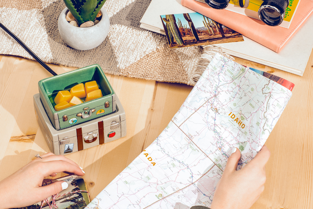Photo of Pack Your Bags warmer styled with travel map and trip photos