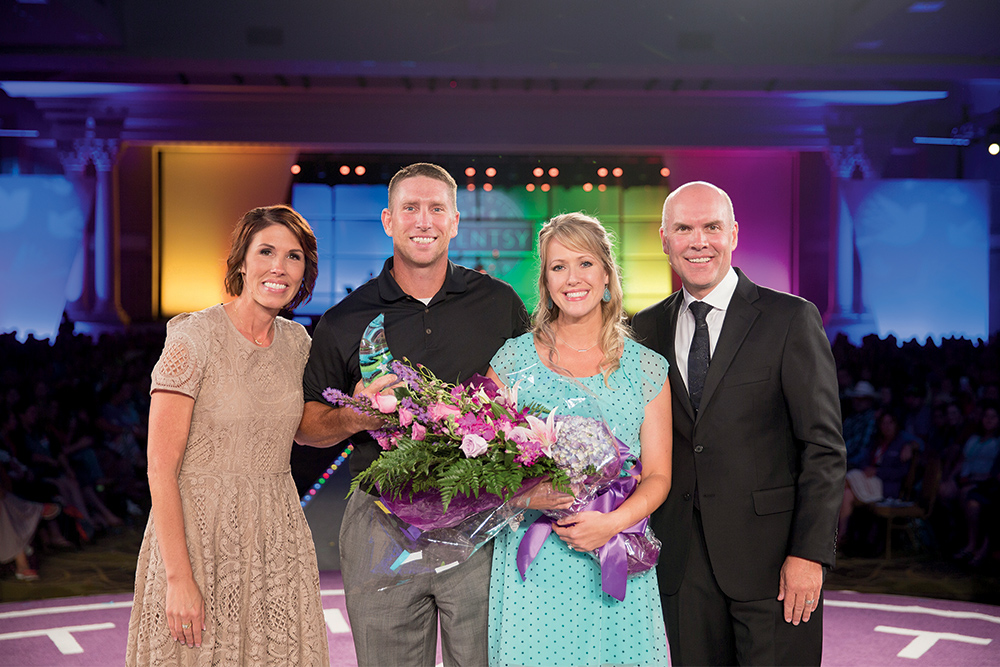 Photo of Scentsy's CEO Heidi and Orville recognizing consultant at SFR