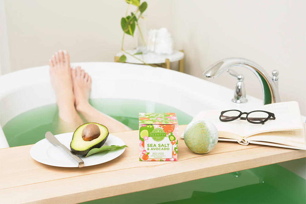 Photo of woman relaxing in bath with a Sea Salt and Avacado Scentsy Bath Bomb