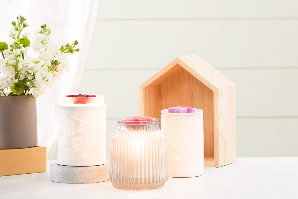 Photo of scentsy warmers atop a entry console