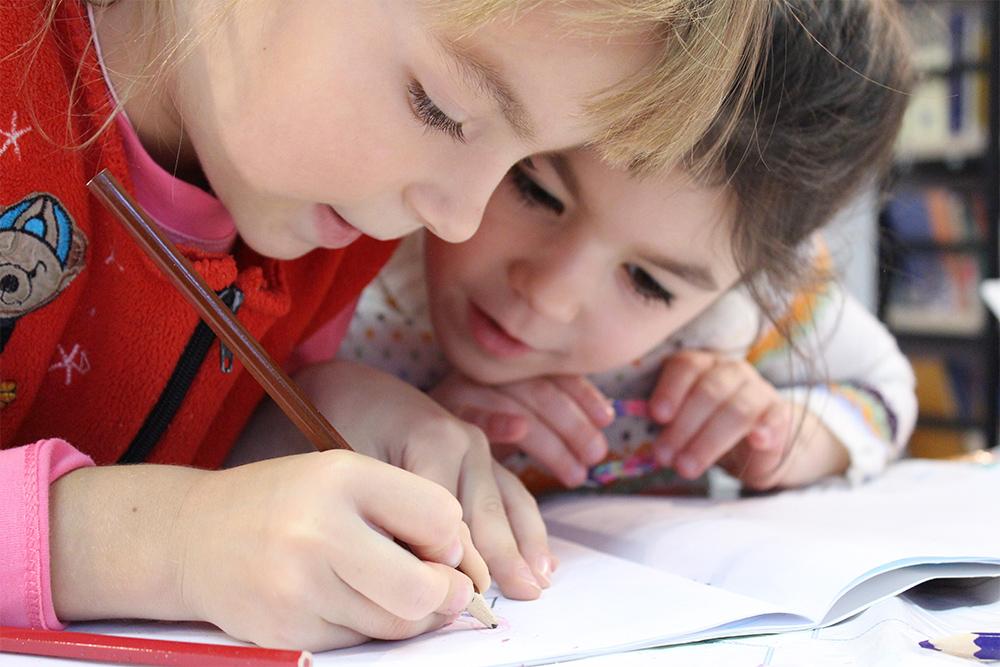 Photo of children working in school book