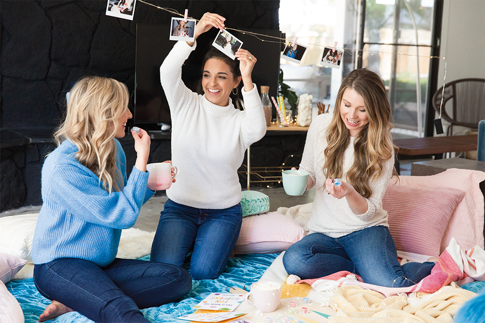 Photo of consultant and friends enjoying a cozy hygge themed party