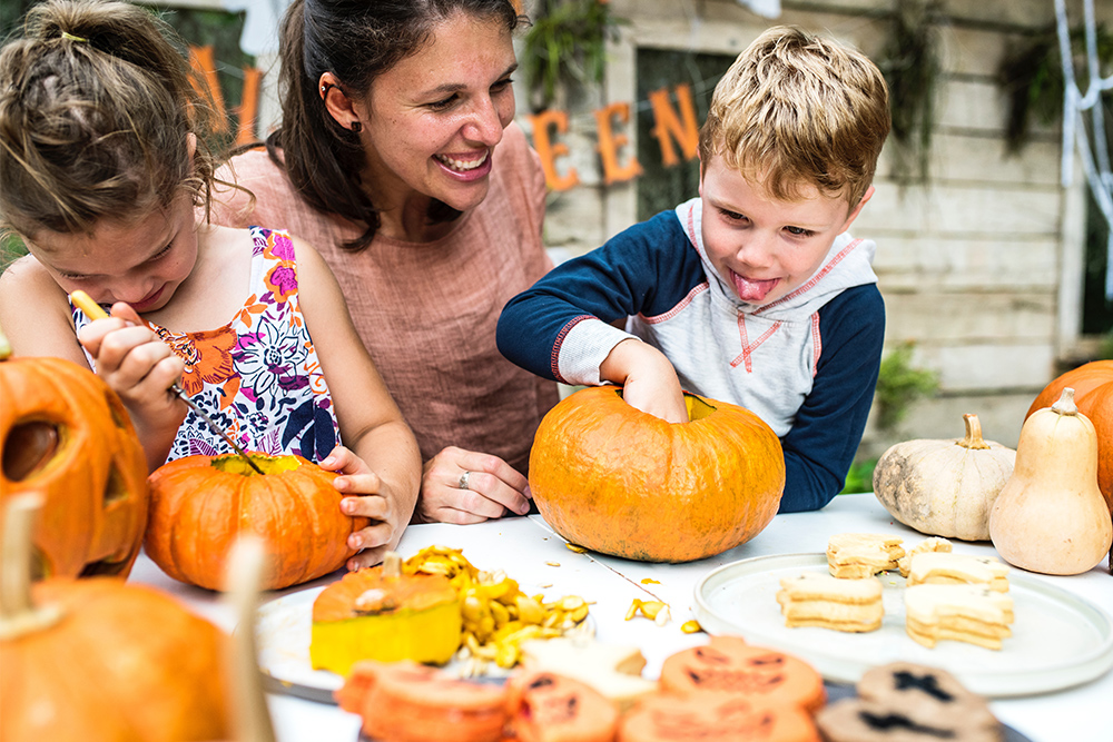 Photo of family carving pumpkins