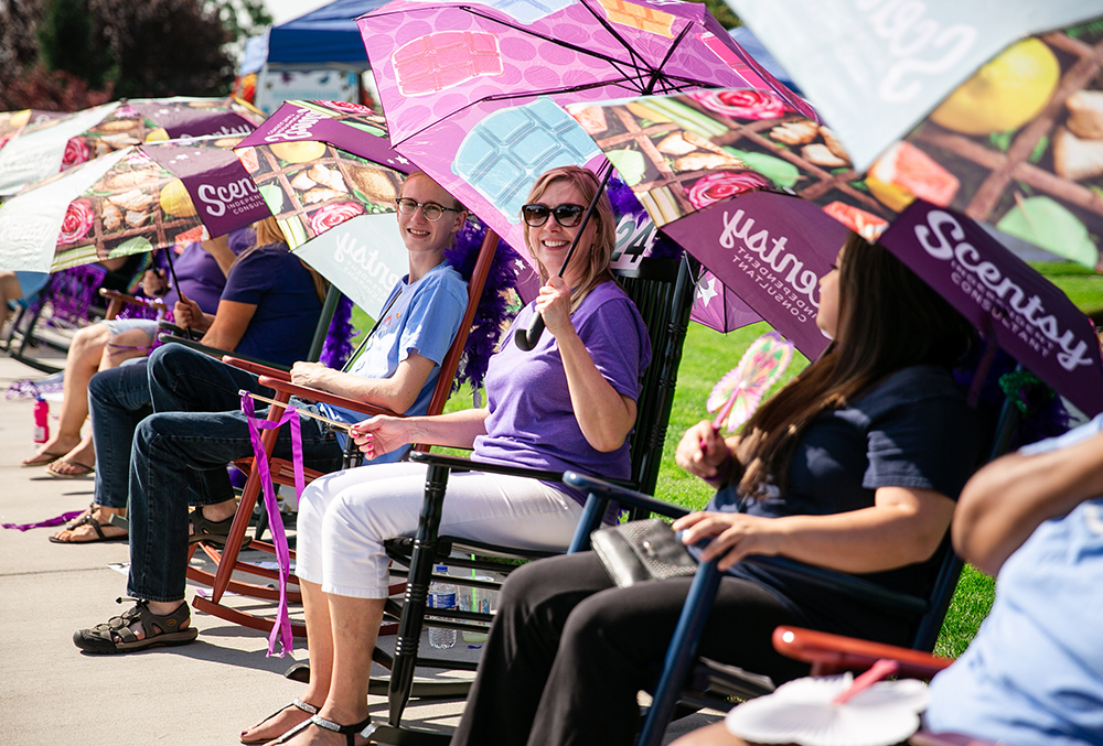 Photos of happy consultants on rocking chairs at Scentsy RockAThon