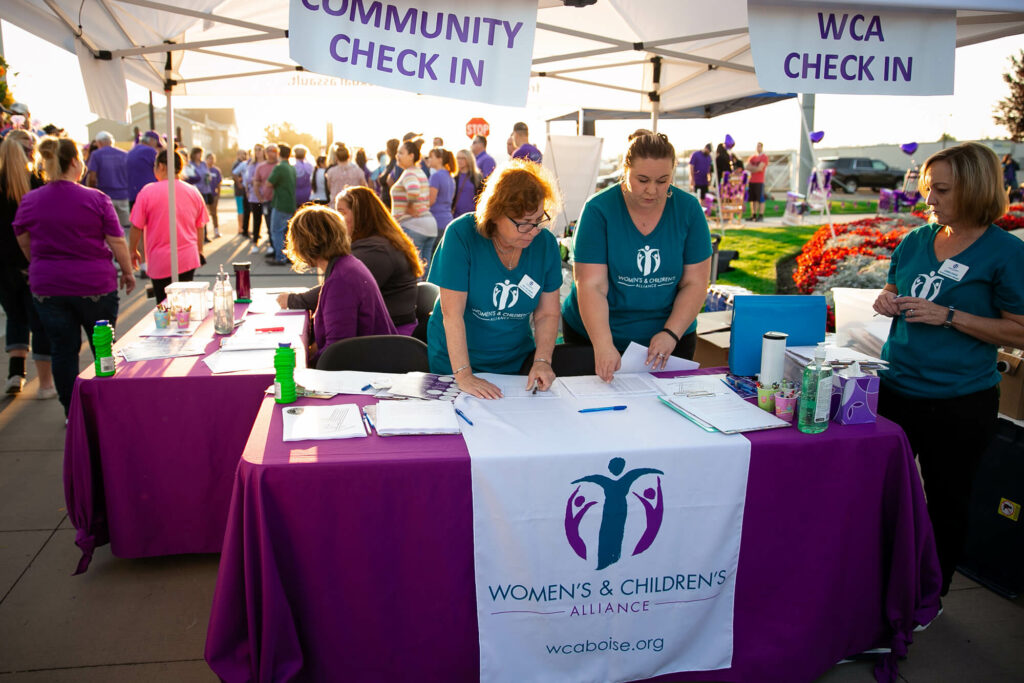 Scentsy volunteers at the Women's & Children's alliance booth